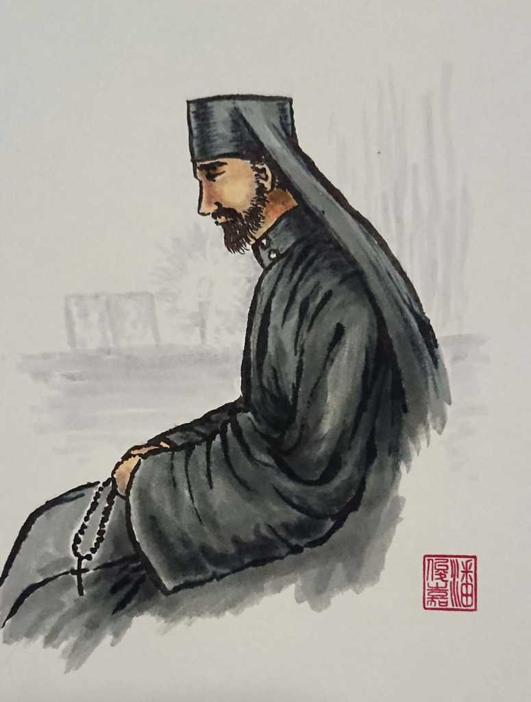 Hieromonk praying with chotki (prayer robe)